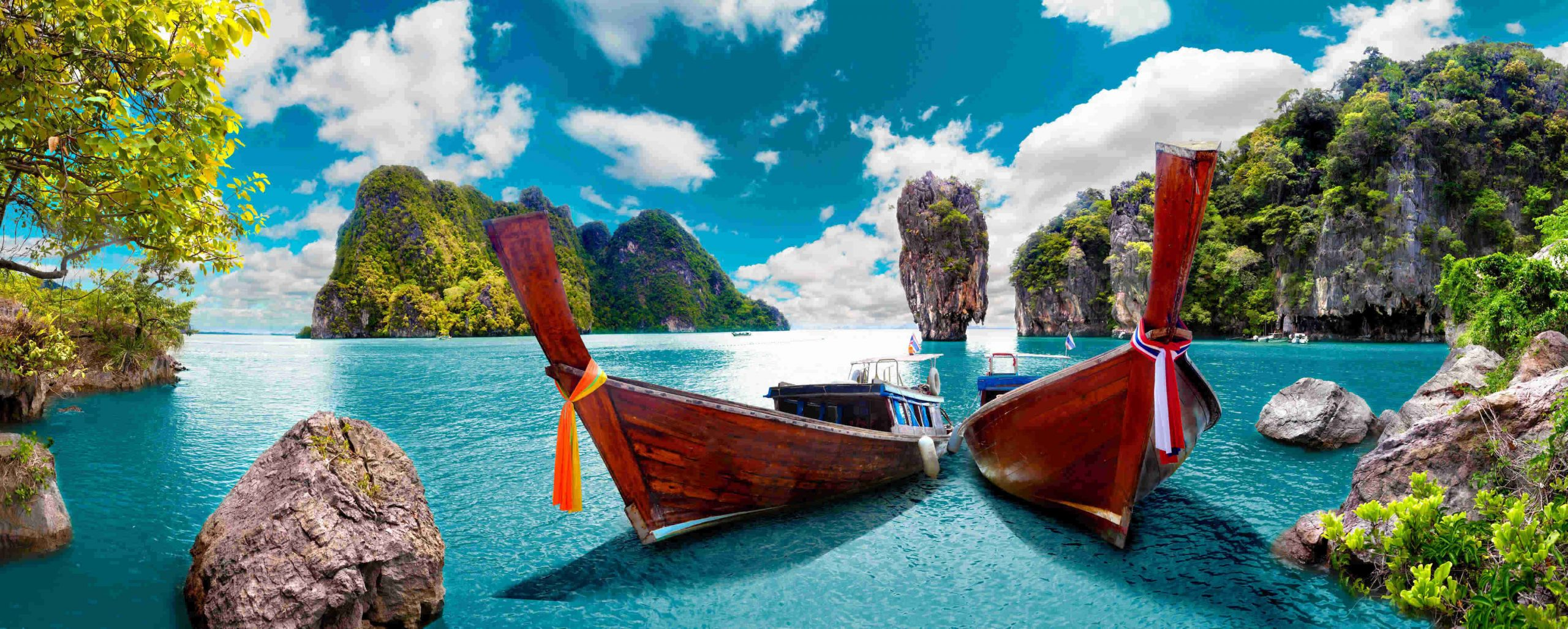 Scenic beaches of Thailand with long tail boats