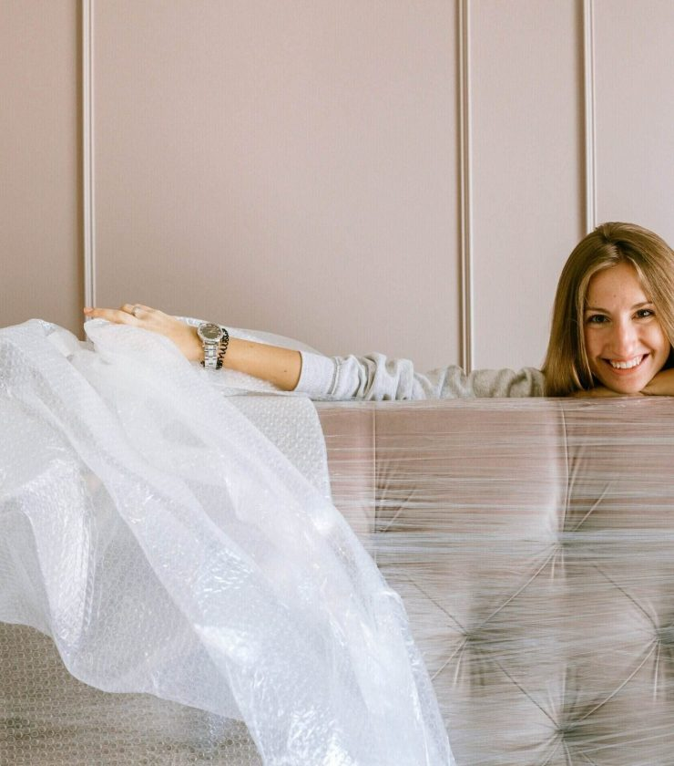 Women unpacking and smiling